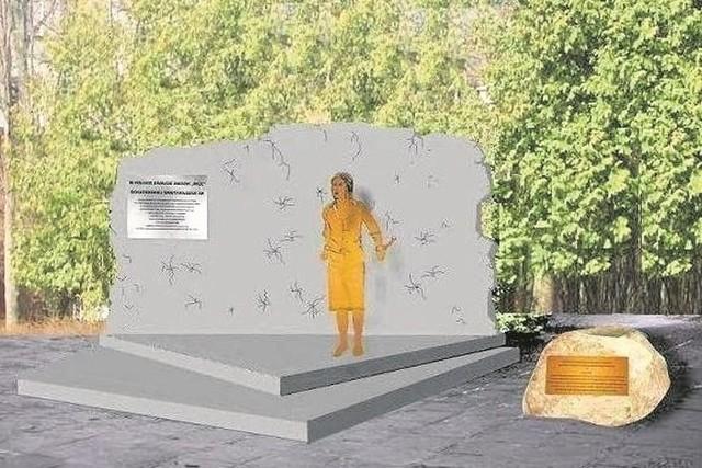 Inka będzie stała na tle ściany z niewielkimi wyrwami symbolizującymi kule. Obok będzie leżał głaz z tablicą.
