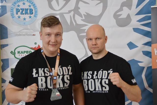 Tomasz Koniarski i trener Grzegorz Goliński