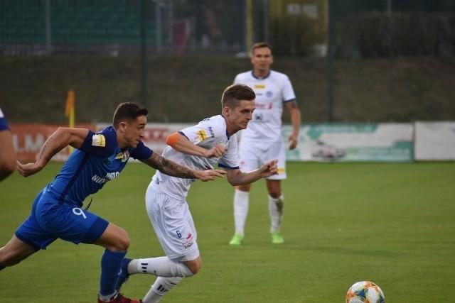 Grzegorz Aftyka zagrał przeciw Puszczy Niepołomice jako piłkarz Wigier Suwałki, przegrywając 1:2