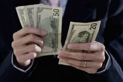 Bogaci płacą podatki za granicą Fot. Ingimage
