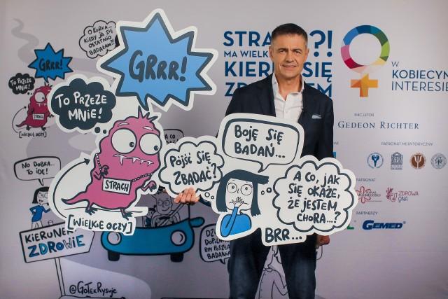 """Znany kierowca rajdowy Krzysztof Hołowczyc namawia panie do badań w trzeciej edycji kampanii """"W kobiecym interesie""""."""