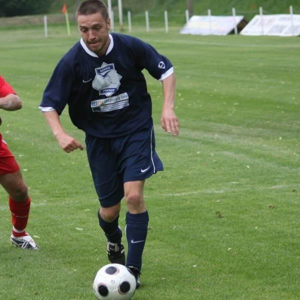 Wojciech Burzyński uratował punkt dla Rajfela.