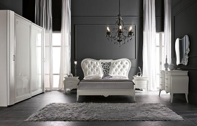 Sypialnia wyposażona w meble linii Fusion włoskiej firmy Treci.  Białe meble, czarne ściany – zaskakujące w sypialni, ale całość wygląda doskonale. Na zdjęciu meble linii Fusion włoskiej firmy Treci.