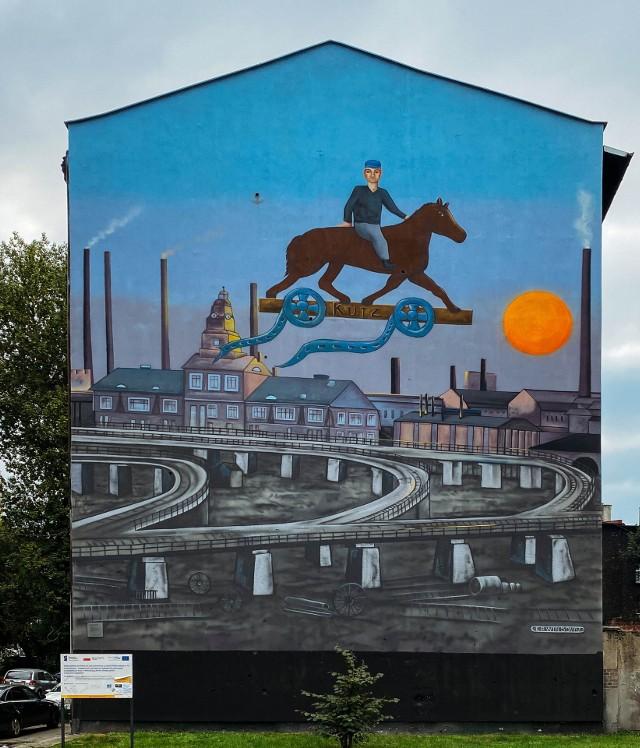 Mural namalowany na ścianie familoka, w którym wychowywał się Kazimierz Kutz. Zaprojektowany przez Erwina Sówkę, autorami są NIETAK.eu i Łukasz Zasadni
