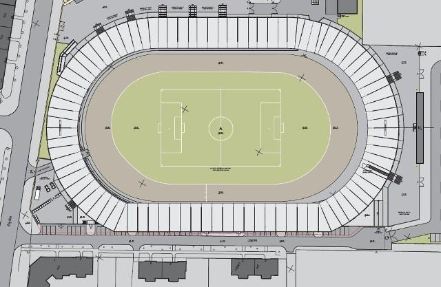 Lokatorzy z ul. Jasnej (ich kamienice są zaznaczone ciemnym kolorem, to trzy budynki na ilustracji ,,pod'' stadionem) domagają się ekranów akustycznych, które wytłumią stadionowy hałas.