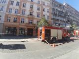 Pożar w mieszkaniu przy ul. Piotrkowskiej. Kobieta doznała poparzeń twarzy ZDJĘCIA