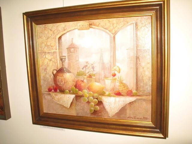 """Jeden z obrazów ma motyw żniński. Nosi tytuł """"Jesienna biesiada"""". Do namalowania tego obrazu namówiła go żona Wanda."""