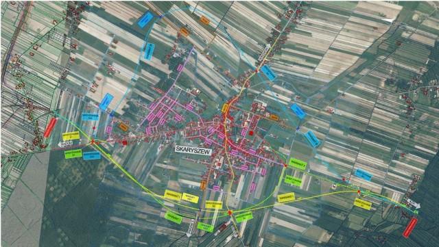 Trzy zaproponowane warianty (żółty, zielony i niebieski) przebiegu obwodnicy Skaryszewa w ciągu drogi krajowej numer9.