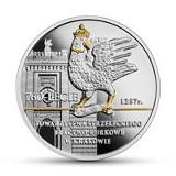 Srebrny kur krakowskiego Bractwa Kurkowego na monecie kolekcjonerskiej
