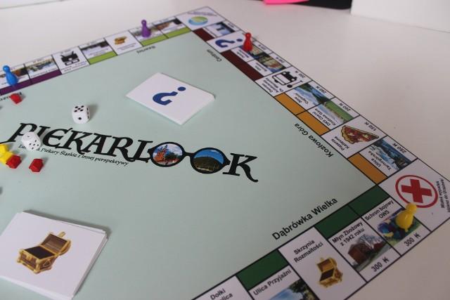 """Gra """"Piekarlook"""" ukaże się pod koniec lipca. To pierwsza planszówka poświęcona Piekarom Śląskim.Zobacz kolejne zdjęcia. Przesuwaj zdjęcia w prawo - naciśnij strzałkę lub przycisk NASTĘPNE"""