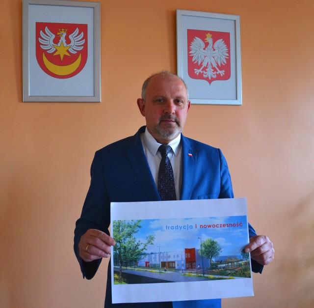 Jacek Hudyma z wizualizacją nowego ośrodka w Dwudniakach. Ma on powstać  po rozbudowie nieczynnej szkoły