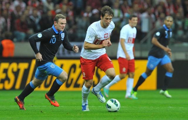 Wayne Rooney i Grzegorz Krychowiak w meczu Polska - Anglia (1:1) w Warszawie (17.10.2012) w ramach kwalifikacji do mistrzostw świata w Brazylii 2014
