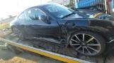 Kalisz: Pracownik myjni samochodowej ukradł porsche i rozbił je na płocie [ZDJĘCIA]