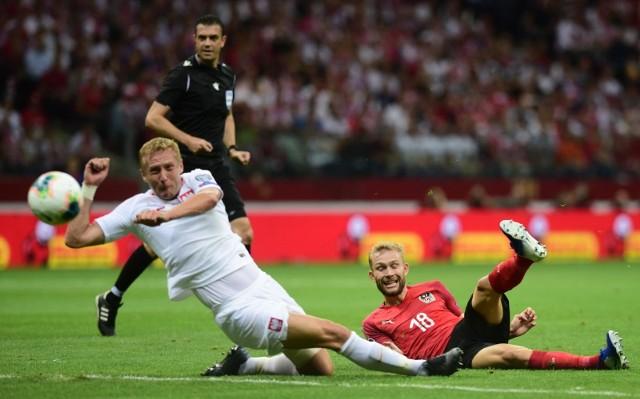 Polska zremisowała z Austrią 0:0 w szóstej kolejce eliminacji mistrzostw Europy 2020. Zobacz zdjęcia z rywalizacji na PGE Narodowym w Warszawie i jak na trybunach bawili się kibice.