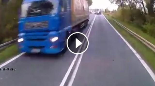 Kirowca TIRa wyprzedza na ciągłej linii i na łuku drogi