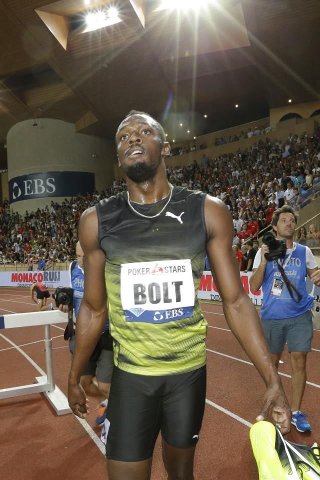 """""""Usain Bolt jest legendą"""" - głosi wielka reklama w centrum handlowym tuż przed Stadionem Olimpijskim w Londynie."""