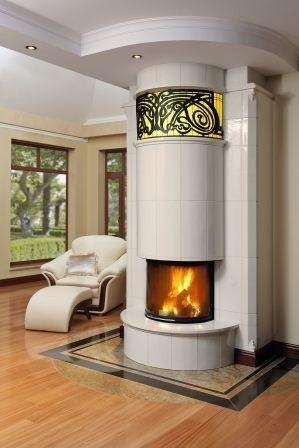 Kamień wokół kominka połączony z drewnianą podłogąKamień wokół kominka można wkomponować w drewnianą podłogę.