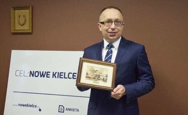 Poseł Arur Gierda przekazał obraz przedstawiający Sejm RP.