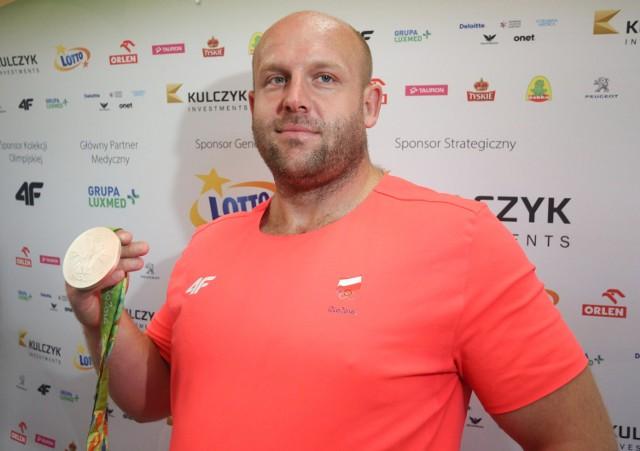 Kulczykowie odkupią srebrny medal Piotra Małachowskiego