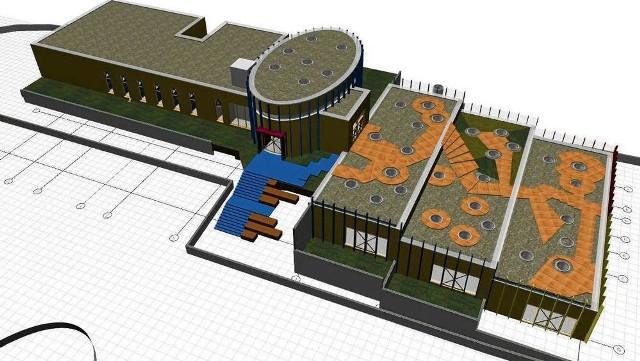 Owalna część to aula, na lewo od niej – zaplecze kuchenno-socjalne, na prawo – sale przedszkolne