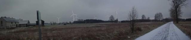 Fotomontaż farmy wiatrowej wykonany z drogi powiatowej Kurzelów - Jeżowice z odległości około 1300 metrów od najbliższych turbin.