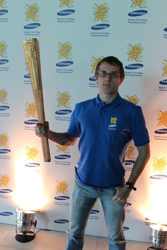 Rafał Koszyk (AZS UMCS Lublin) z londyńską pochodnią olimpijską