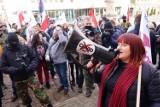 """Iwan Komarenko i Justyna Socha na marszu koronasceptyków w Poznaniu. """"Jesteś opłacany przez pedofilów"""""""