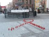 W Światowy Dzień Walki z AIDS zapłonęły znicze pod Neptunem