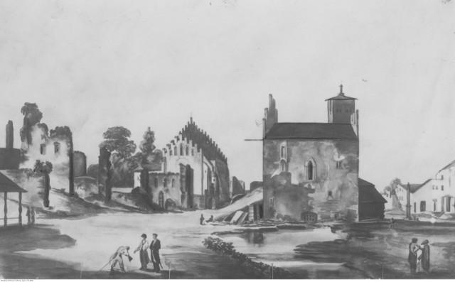 Fragment kościoła i ratusza w Olkuszu.  Zdjęcie starej ryciny.