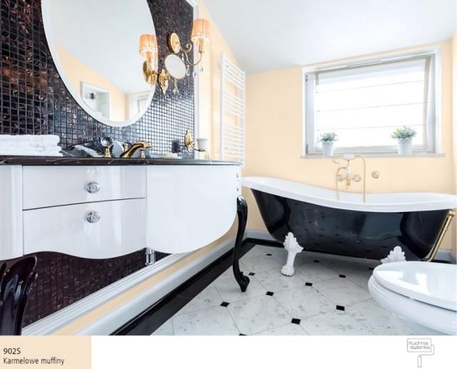 Czerń i złoto idealnie pasują do wystroju łazienki, tworząc oryginalne i szlachetne wnętrze. Eleganckie złote baterie łazienkowe będą pięknie odbijały się na tle czarnych kafelków, a pomalowane na kolory pochodzące z palety off-white ściany, nadadzą łazience lekkości i relaksującego charakteru.